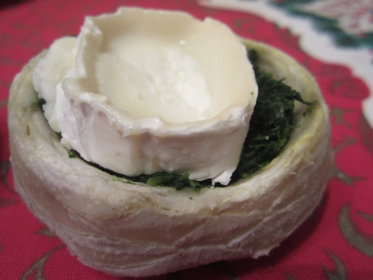 Artichoke filled with spinach and topped with goat cheese